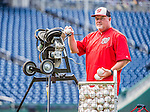 22 May 2015: Washington Nationals Bullpen Coach Matthew LeCroy operates the pitching machine prior to a game against the Philadelphia Phillies at Nationals Park in Washington, DC. The Nationals defeated the Phillies 2-1 in the first game of their 3-game weekend series. Mandatory Credit: Ed Wolfstein Photo *** RAW (NEF) Image File Available ***