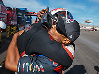 Oct 28, 2018; Las Vegas, NV, USA; NHRA top fuel dragster driver Steve Torrence (left) is congratulated by Antron Brown as he celebrates after clinching the 2018 top fuel world championship during the Toyota Nationals at The Strip at Las Vegas Motor Speedway. Mandatory Credit: Mark J. Rebilas-USA TODAY Sports