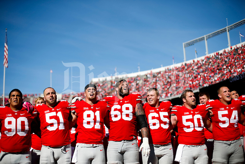 "Ohio State Buckeyes offensive lineman Taylor Decker (68), center, sings ""Carmen Ohio"" with his teammates following the Buckeyes 49-28 victory against the Maryland Terrapins on Saturday, October 10, 2015 at Ohio Stadium in Columbus, Ohio. (Joshua A. Bickel/The Columbus Dispatch)"
