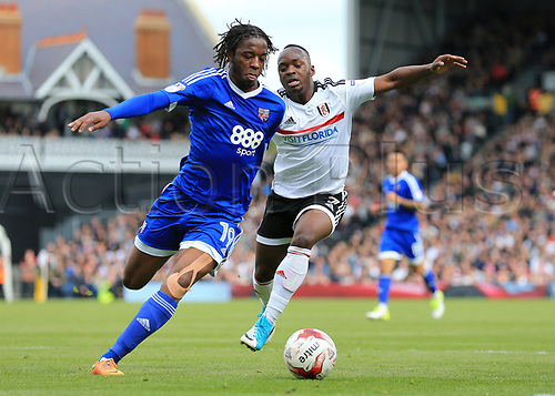 April 29th 2017, Craven Cottage, Fulham, London, England; Skybet Championship football, Fulham FC versus Brentford; Romaine Sawyers of Brentford runs passed Neeskens Kebano of Fulham