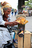 BRAZIL, Rio de Janiero, a woman sells com ou sem cascas on the streets of the Financial District