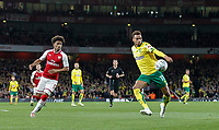 Josh Murphy of Norwich City hits at shot at goal under pressure from Reiss Nelson of Arsenal during the Carabao Cup match between Arsenal and Norwich City at the Emirates Stadium, London, England on 24 October 2017. Photo by Carlton Myrie.