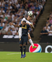Ben Davies of Tottenham Hotspur beats Thomas Lemar of Monaco in the air during the UEFA Champions League Group stage match between Tottenham Hotspur and Monaco at White Hart Lane, London, England on 14 September 2016. Photo by Andy Rowland.