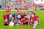 Children and familys from the Glow Heart for Crumlin release 99 red balloons at St Mary's Cathedral on Saturday