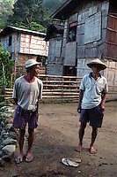 Two elder residents of a hamlet poses for a picture. Malibcong, Abra, Philippines. August, 1999