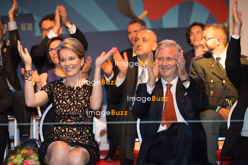King Philippe and Queen Mathilde of Belgium attend the National Ball, an evening of concerts on the eve of Belgium's National Day at the Place du jeu de balles in Brussels.<br /> Belgium, Brussels, July 20, 2014.<br /> Le Roi Philippe et la Reine Mathilde de Belgique assistent au Bal National dans le quartier populaire des Marolles, &agrave; Bruxelles,  &agrave; la veille de la c&eacute;l&eacute;bration de la f&ecirc;te Nationale belge.<br /> Belgique, Bruxelles, 20 juillet 2014.