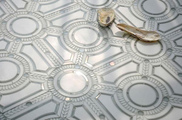 Augustus, a stone and glass waterjet mosaic, shown in Thassos honed, Thassos tumbled, and Tropical White glass. Designed by Sara Baldwin for New Ravenna.<br />