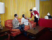 Waiter serving young couple in the lounge at the Desert Inn, Daytona Beach Florida 1970's