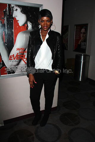 "BEVERLY HILLS, CA - FEBRUARY 28: Caroline Chikezie at the ""Everly"" Opening Weekend Splatter-Ganza at Laemmle's Music Hall, Beverly Hills, California on February 28, 2015. Credit: David Edwards/DailyCeleb/MediaPunch"