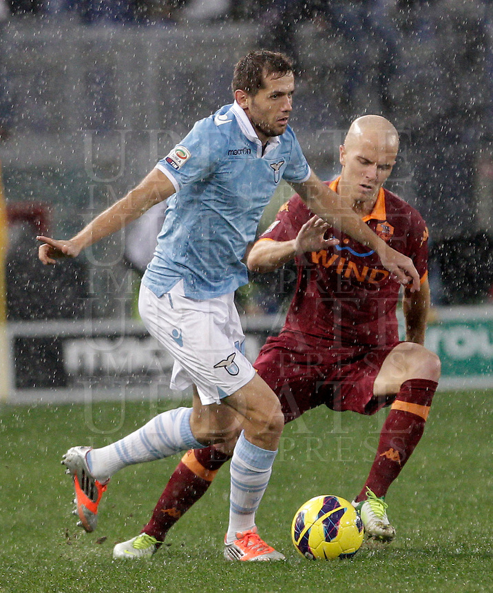 Calcio, Serie A: Lazio vs Roma. Roma, stadio Olimpico, 11 novembre 2012..Lazio midfielder Senad Lulic, of Bosnia, is challenged by AS Roma midfielder Michael Bradley, of the United States, during the Italian Serie A football match between Lazio and AS Roma, at Rome's Olympic stadium, 11 November 2012..UPDATE IMAGES PRESS/Riccardo De Luca