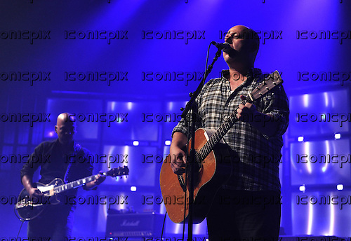 PIXIES - Joey Santiago and Black Francis - performing live on Day 25 of the iTunes Festival at The Roundhouse in London UK - 25 Sep 2013.  Photo credit: George Chin/IconicPix