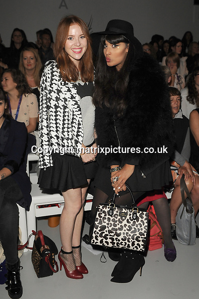 NON EXCLUSIVE PICTURE: PAUL TREADWAY / MATRIXPICTURES.CO.UK<br /> PLEASE CREDIT ALL USES<br /> <br /> WORLD RIGHTS<br /> <br /> British model and blogger Angela Scanlon and British television personality Jameela Jamil attend the Holly Fulton catwalk show during London Fashion Week S/S 2014 in London.<br /> <br /> 14TH SEPTEMBER 2013<br /> <br /> REF: PTY 136114