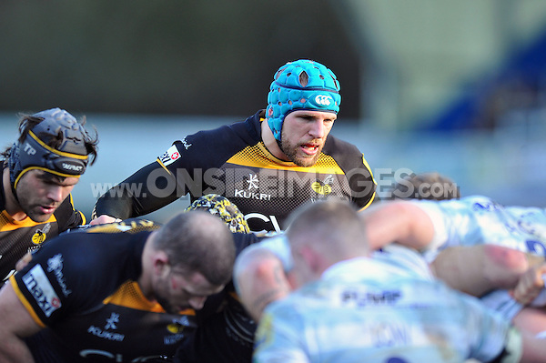 James Haskell and the rest of the Wasps forwards pack down for a scrum. Aviva Premiership match, between London Wasps and London Irish on February 15, 2014 at Adams Park in High Wycombe, England. Photo by: Patrick Khachfe / JMP