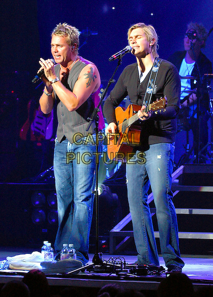 JOURNEY SOUTH - ANDY PEMBERTON & CARL PEMBERTON.Live at Sheffield City Hall, UK..October 4th, 2006.Ref: CAP/DAR.stage live concert gig perforamance music full length singing jeans denim grey gray vest black guitar.www.capitalpictures.com.sales@capitalpictures.com.©Darwin/Capital Pictures