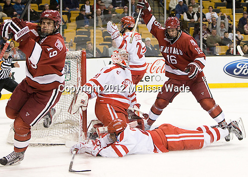 Alex Killorn (Harvard - 19) and Alex Fallstrom (Harvard - 16) celebrate Killorn's goal. - The Boston University Terriers defeated the Harvard University Crimson 3-1 in the opening round of the 2012 Beanpot on Monday, February 6, 2012, at TD Garden in Boston, Massachusetts.