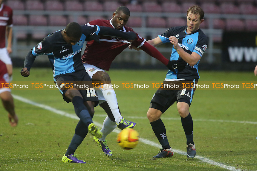 Wycombe's Kortney Hause clears the ball upfield under pressure from Northampton's Izale  McLeod - Northampton Town vs Wycombe Wanderers - Sky Bet League Two Football at the Sixfields Stadium, Northampton - 21/12/13 - MANDATORY CREDIT: Paul Dennis/TGSPHOTO - Self billing applies where appropriate - 0845 094 6026 - contact@tgsphoto.co.uk - NO UNPAID USE