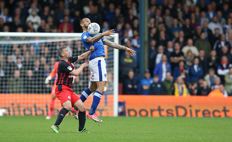 Oldham Athletic's Craig Davies and Blackburn Rovers' Paul Caddis<br /> <br /> Photographer Stephen White/CameraSport<br /> <br /> The EFL Sky Bet League One - Oldham Athletic v Blackburn Rovers - Saturday 14th October 2017 - Boundary Park - Oldham<br /> <br /> World Copyright &copy; 2017 CameraSport. All rights reserved. 43 Linden Ave. Countesthorpe. Leicester. England. LE8 5PG - Tel: +44 (0) 116 277 4147 - admin@camerasport.com - www.camerasport.com