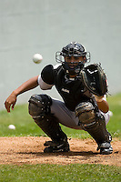 Catcher Rene Garcia (5) of the Greeneville Astros warms up the pitcher in the bullpen at Bowen Field in Bluefield, WV, Sunday July 6, 2008. (Photo by Brian Westerholt / Four Seam Images)