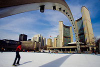 Toronto (ON) CANADA October 2001 - File Photo - .People ice skating on Nathan Phillips Square, in front of Toronto City Hall...The City Hall of Toronto, Ontario, Canada is one of the most distinctive landmarks of the city. Designed by Finnish architect Viljo Revell (with Heikki Castr??n, Bengt Lundsten, Seppo Valjus) and engineered by Hannskarl Bandel, the building opened in 1965; its modernist architecture still impresses today. It was built to replace Old City Hall which was built in 1899....photo by Pierre Roussel - Images Distribution
