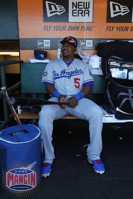 SAN FRANCISCO, CA - JUNE 27:  Juan Uribe #5 of the Los Angeles Dodgers sits in the dugout before the game against the San Francisco Giants at AT&T Park on Wednesday, June 27, 2012 in San Francisco, California. Photo by Brad Mangin