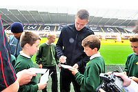 SWANSEA....<br /> WITH STORY....PREMIER LEAGUE READING STARS EVENT....<br /> THURSDAY 25th SEPTEMBER 2014<br /> Gylfi Sigurdsson signs autographs during the Premier League Reading Stars event at the Liberty Stadium.