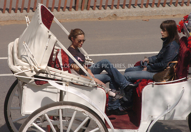 WWW.ACEPIXS.COM ** ** **NON-EXCLUSIVE!!! FEE MUST STILL BE NEGOTIATED BEFORE USE!!!***....NEW YORK, APRIL 26, 2005....Angelina Jolie and son Maddox Jolie take leave of their midtown hotel for a beautiful carriage ride through Central Park. Along the way, Maddox eats a giant pretzel and occasionally offers Angelina Jolie a bit now and again. Throughout the ride, Angelina is a completely attentive mother, making her son laugh and holding his extra pretzel bits.......Please byline: Philip Vaughan -- ACE PICTURES... *** ***  ..Ace Pictures, Inc:  ..Craig Ashby (212) 243-8787..e-mail: picturedesk@acepixs.com..web: http://www.acepixs.com
