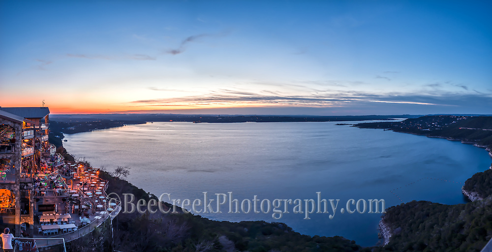 This is a landscape view of the  Oasis after dark on Lake Travis with what is left of the sunsets as it is starting to fade and only the lights from restaurant and the light left in the sky illuminate the lake in this panorama.  Alway a great place to go no matter when you go there is always a view of some kind.