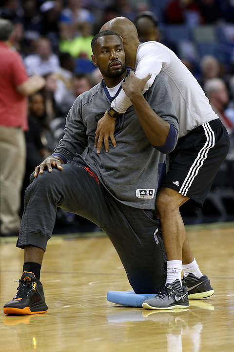 Oklahoma City Thunder forward Serge Ibaka works with a trainer before an NBA basketball game Thursday, Feb. 25, 2016, in New Orleans. (AP Photo/Jonathan Bachman)