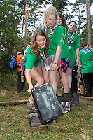 Irish girlscouts uses boxes to get to the goal, without stepping in the grass.