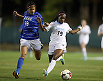 31 October 2013: North Carolina's Crystal Dunn (right) and Duke's Kim DeCesare (left). The University of North Carolina Tar Heels hosted the Duke University Blue Devils at Fetzer Field in Chapel Hill, NC in a 2013 NCAA Division I Women's Soccer match. North Carolina won the game 3-0.
