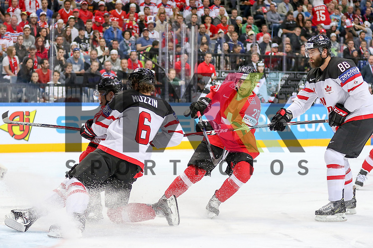 Schweizs Hollenstein, Denis (Nr.70) bremst in den Puck gegen Canadas Muzzin, Jake (Nr.6) mit Schweizs Suri, Reto (Nr.26)  im Spiel IIHF WC15 Schweiz vs. Canada.<br /> <br /> Foto &copy; P-I-X.org *** Foto ist honorarpflichtig! *** Auf Anfrage in hoeherer Qualitaet/Aufloesung. Belegexemplar erbeten. Veroeffentlichung ausschliesslich fuer journalistisch-publizistische Zwecke. For editorial use only.