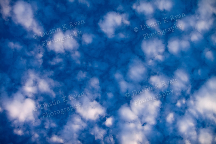 Blue Sky and puffy clouds abstract image