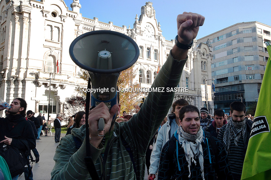 A young man throws slogans during the morning of the general strike of 14-n in Santander (Spain). As a result of government cuts protests by workers, students yotros groups have increased..photo © JOAQUIN GOMEZ SASTRE
