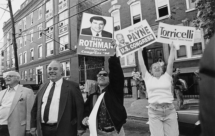 People holding placards at New Jersey 96 races during a Senate campaign rally in 1996. (Photo by Rebecca Roth/CQ Roll Call)