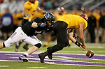 SIOUX FALLS, SD - SEPTEMBER 8: Dennis Gardeck #47 from the University of Sioux Falls brings down quarterback Jake Comeaux #7 from Northern State after Comeaux fumbled the snap in the first half of their game Saturday night at Bob Young Field in Sioux Falls. (Photo by Dave Eggen/Inertia)