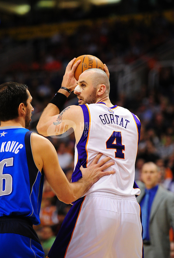 Mar. 27, 2011; Phoenix, AZ, USA; Phoenix Suns forward (4) Marcin Gortat against the Dallas Mavericks at the US Airways Center. The Maverick defeated the Suns 91-83. Mandatory Credit: Mark J. Rebilas-