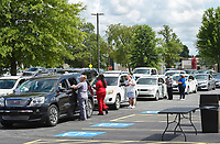 Volunteers check-in drivers, Friday, June 26, 2020 during a mass covid-19 screening at the Northwest Arkansas Community College in Bentonville. The Arkansas Department of Health hosted a mass screening for anyone at the campus. Their goal was to administer 500 covid-19 tests. NWACC provided the facility and volunteers. UAMS and Mercy Hospital also provided volunteers. Check out nwaonline.com/200627Daily/ for today's photo gallery. <br /> (NWA Democrat-Gazette/Charlie Kaijo)