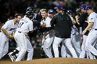 Adam Engel (center) is mobbed by his teammates after hitting a walk-off single in the bottom of the 11th inning against the Potomac Nationals at BB&T Ballpark on May 13, 2016 in Winston-Salem, North Carolina.  The Dash defeated the Nationals 5-4 in 11 innings.  (Brian Westerholt/Four Seam Images)