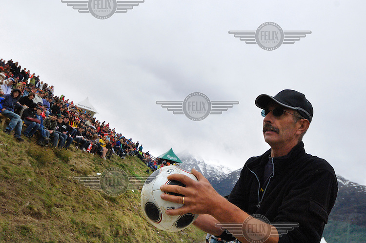 A spectator surprised to find the ball in his hands at the other official Euro 2008 football tournament: the European Championship of Mountain Villages. The tournament was held at the summer training ground of hosts FC Gspon, standing at 2008 metres above sea-level,  and surrounded by 4000 metre alpine peaks. It is the highest football pitch in Europe, and reachable only by cable car, or a long walk. Amateur league teams from eight countries took part.