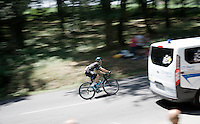 Nicolas Roche (IRL/SKY) speeding in the convoy as he is getting back to the peloton between the race cars.<br /> <br /> stage 10: Tarbes - La Pierre-Saint-Martin (167km)<br /> 2015 Tour de France