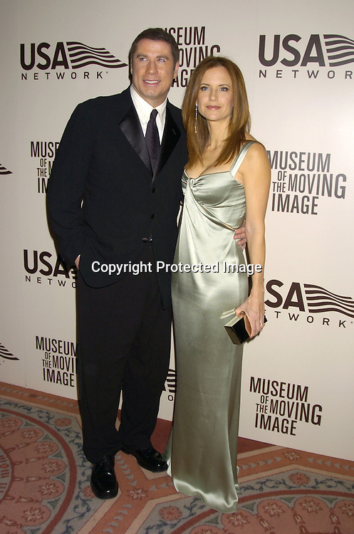 John Travolta and wife Kelly Preston ..at the American Museum of the Moving Image salute to John Travolta on December 5, 2004 at The Waldorf Astoria ..Hotel. ..Photo by Robin Platzer, Twin Images