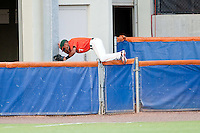 June 11, 2010:    Miami Outfielder Zeke DeVoss (7) goes head first over the left field fence while chasing a foul ball during game one of NCAA Gainesville Super Regional action between the University of Florida Gators and Miami Hurricanes at Alfred A. McKethan Stadium on the campus of University of Florida in Gainesville.   Florida defeated Miami 7-2 to take a 1-0 lead in the best of three series............