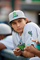 Lynchburg Hillcats pitcher Eli Morgan (34) in the dugout before the second game of a doubleheader against the Frederick Keys on June 12, 2018 at Nymeo Field at Harry Grove Stadium in Frederick, Maryland.  Frederick defeated Lynchburg 8-1.  (Mike Janes/Four Seam Images)