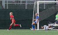 Allston, Massachusetts - May 1, 2016:  In a National Women's Soccer League (NWSL) match, Portland Thorns FC (red) defeated Boston Breakers (blue), 1-0, at Jordan Field.<br /> <br /> Dagny Brynjarsdottir celebrates score.