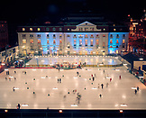 AUSTRIA, Vienna, elevated view of ice skaters outside Concert House at night. The view is from a window of a room at the Intercontinental Hotel