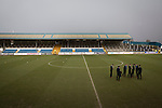 Visiting players wearing suits inspect the pitch before Greenock Morton take on Stranraer in a Scottish League One match at Cappielow Park, Greenock. The match was between the top two teams in Scotland's third tier, with Morton winning by two goals to nil. The attendance was 1,921, above average for Morton's games during the 2014-15 season so far.