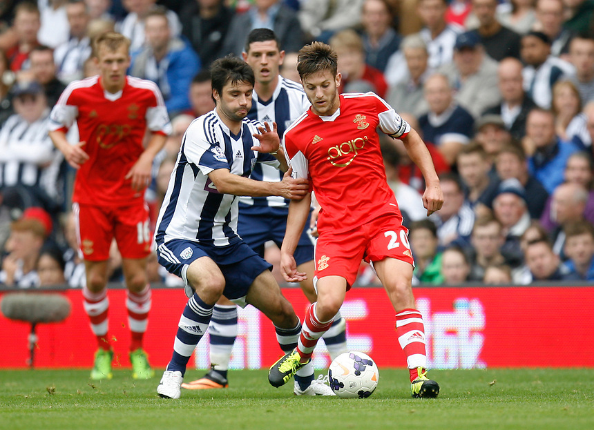 Southampton's Adam Lallana (R) and West Bromwich Albion's Claudio Yacob in action during todays match  <br /> <br />  (Photo by Jack Phillips/CameraSport) <br /> <br /> Football - Barclays Premiership - West Bromwich Albion v Southampton - Saturday 17th August 2013 - The Hawthorns - West Bromwich<br /> <br /> &copy; CameraSport - 43 Linden Ave. Countesthorpe. Leicester. England. LE8 5PG - Tel: +44 (0) 116 277 4147 - admin@camerasport.com - www.camerasport.com