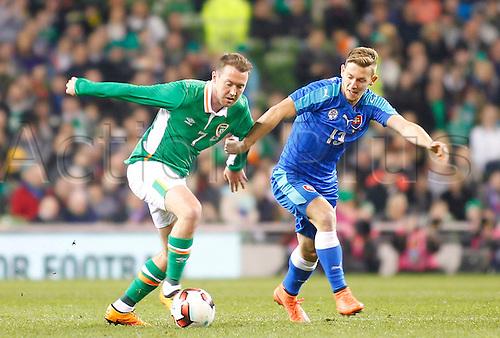 29.03.2016. Aviva Stadium, Dublin, Ireland.  International Football Friendly Ireland versus Slovakia. Aiden McGeady (Rep. of Ireland) holds off a challenge from Patrik Hrosovsky (Slovakia).
