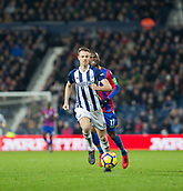 2nd December 2017, The Hawthorns, West Bromwich, England; EPL Premier League football, West Bromwich Albion versus Crystal Palace; Jonny Evans of West Bromwich Albion chasing the ball followed by Christian Benteke of Crystal Palace