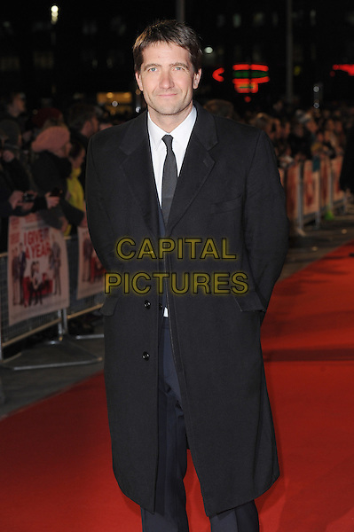 Kris Thykier.attends the UK Premiere of 'I Give It A Year', Vue West End cinema, London, England, UK, 24th January 2013..half length coat suit navy blue black tie .CAP/BEL.©Tom Belcher/Capital Pictures.